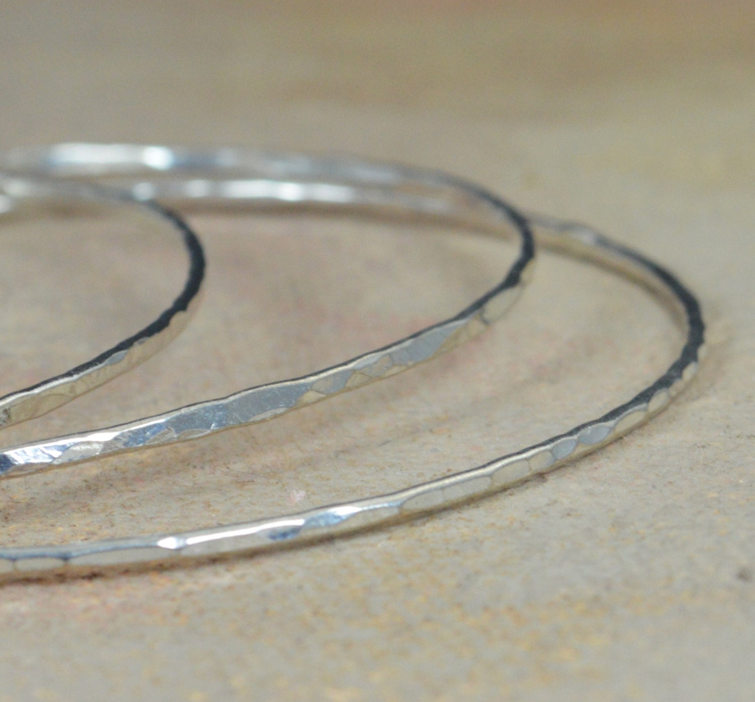 silver lyst bangle oval metallic bangles kors in product bracelets hinged thin michael bracelet jewelry gallery