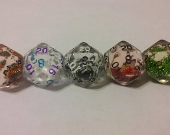 "20 sided die snow globes. liquid center with falling ""snow"" many colors!"