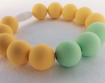 Silicone beaded bracelet mama teether baby pastel