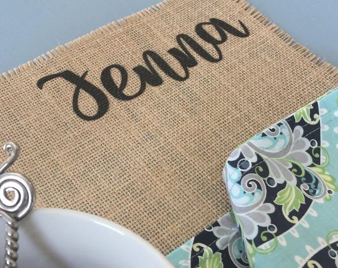 Featured listing image: Personalized burlap placemats for contemporary rustic style home decor with your name in a choice of stylish cheerful fonts
