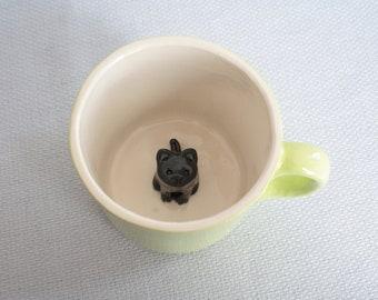 Ceramic lime green mug with black kitten - surprise cup hidden cat figurine earthenware