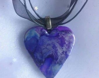Handpainted ceramic heart pendant necklace.