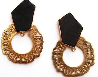 Ebony wood ear danglers with hanging disc.