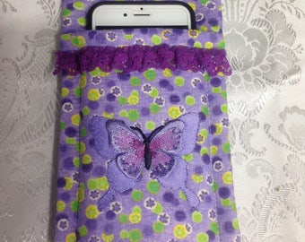 Cell Phone Carrier made with a purple print material and a purple appliqued  butterfly on front