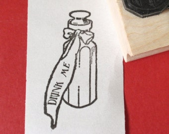 Alice in Wonderland Drink Me Bottle Rubber Stamp  Handmade rubber stamp by Blossom Stamps