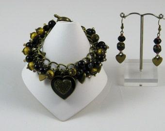 Burnished Heart Bracelet and Earrings - black gold enamelled heart crystal pearl glass bracelet loaded brass antique unique handmade