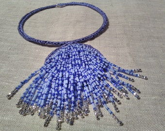 Crochet Necklace ' waterfall ', knitted and decorated with blue/blue shaded glass beads