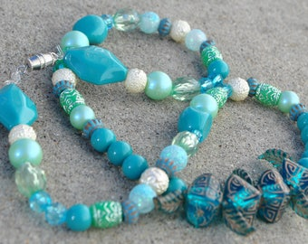 Handmade, turquoise, white, silver,light blue, teal and feathers