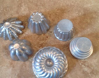 Misfit assortment of tin moulds