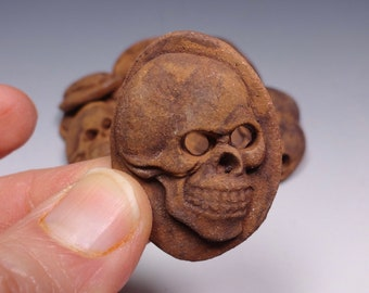 Skull buttons.  Set of 2.  Handmade stoneware. Red stoneware clay with a sandy brown rust oxide wash