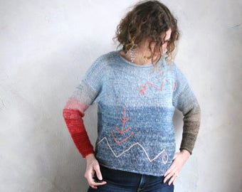 Crew neck roll neck pullover mohair sweater embroidered with Mara tribal symbols