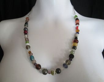 Artist created lampwork glass beaded necklace with silver chain back