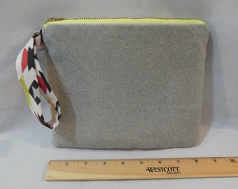 Suede clutch with handle