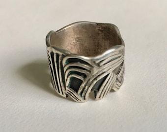 very cool vintage artisan ring in sterling