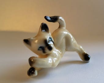 Tiny playful siamese cat figurine
