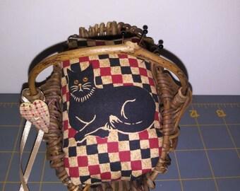 Cat in a basket pincushion