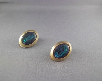 Oval Gold Tone Clip On Earrings With Green Stone
