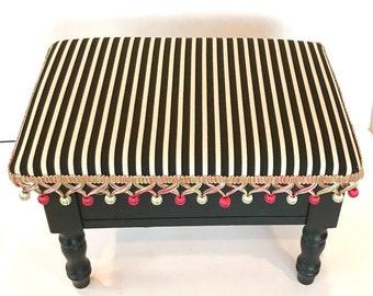 Striped ottoman with storage