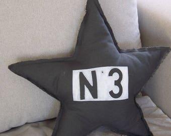 Star cushion in dark grey