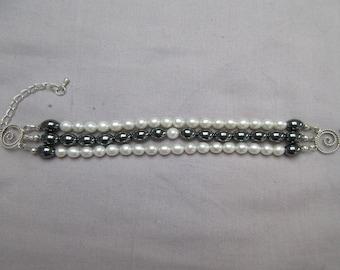 Freshwater Pearl And Hematite Three Strand Bracelet