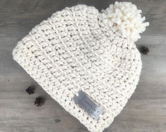 "Quote ""Sarcasm is How I Hug""/ Hygge Hatte Cream Crochet Hat With Pom Pom/ Hand Stamped on Aluminum Tag/Gift For Her/ Personalize"