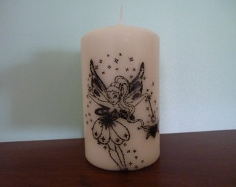 4 inch pillar candle with fairy decoration
