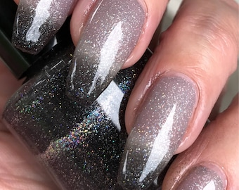 Left to Right - black thermal nail polish with scatter holo glitter
