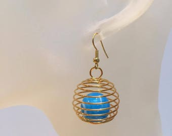 Gilded cage sky blue bead earrings
