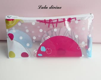 Clear waxed canvas with colorful polka dots, white zip clutch