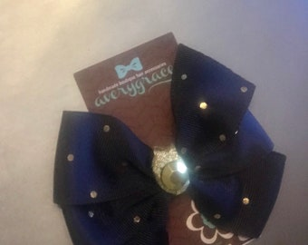Navy and Gold polka dot  4 inch  bow on lined alligator clip with gem center