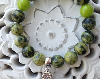 natural stone beads bracelet with wing pendant.