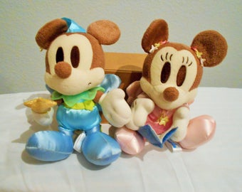 Darling Disney Mickey And Minnie Plush Dressed In Pink And Blue Satin With Wings And A Magic Wand!Minnie Is Reading A Bedtime Story To You!