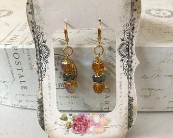 Topaz and green dangle earrings with gold petal bead caps