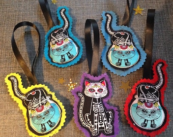 Colourful Cats Halloween decorations skeleton with sugar skull faces, also Christmas ornaments