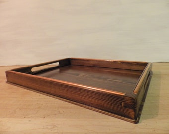 Dark brown cedar wood serving tray with decorative copper trim