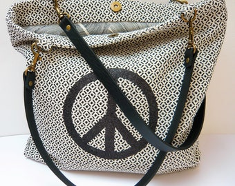 Black and white patterned peace tote bag