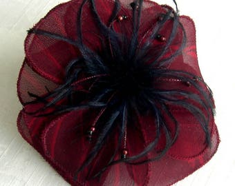 Burgundy fabric flower brooch, black feathers and beads