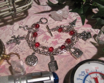 Martha Jones multi-strand charm bracelet in silver-tone base metal and red glass Doctor Who fanart Dr.