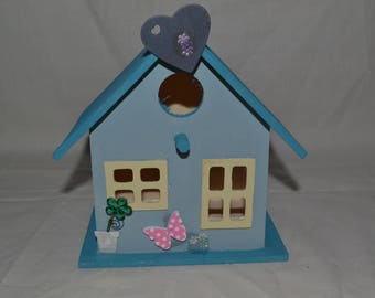 wooden decorated birdhouse