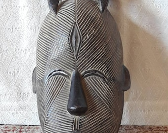 African mask. Attractive hand carved wooden mask from Africa. Very decorative Tribal ritual mask.