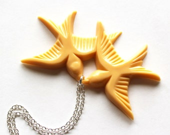 Light peach flying and kissing vintage plastic swallow love birds silver necklace LAST ONE