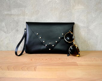 Black leather wrislet clutch with silver metal studs