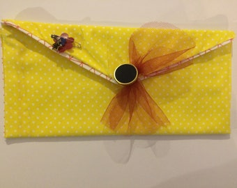 Yellow polka dotted pouch
