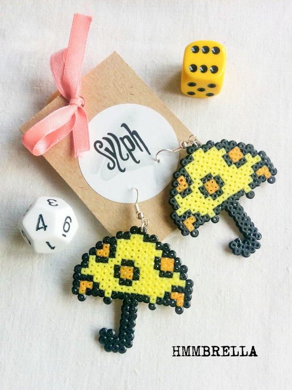 Quirky yellow and orange pixelart Hmmbrella earrings made of Hama Perler beads with white polkadots, an umbrella to brighten up wet days!