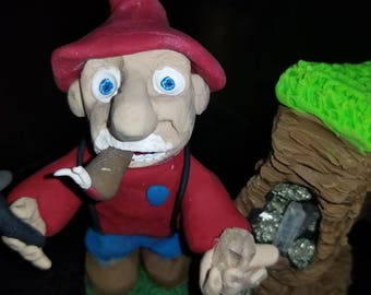 The Miner, polymer clay and natural minerals. Our gnome friend is hard at work and he just found a little treasure inside of the hill