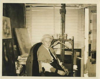 Old artist in studio with paintings easel vintage photo
