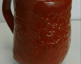 Hand built pottery mug. 12 ounce capasity.
