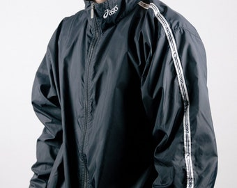 Vintage 1990s black and white Asics zip up Windbreaker with ribbon accents along the sleeve
