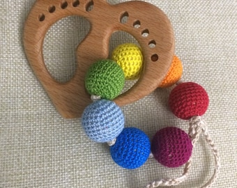 Necklace with rainbow beads with a wooden heart .. teething