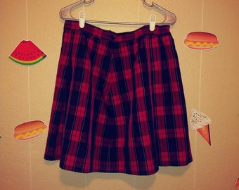 Women size 12 / 14 waist Vintage pleated plaid short school girl skirt.Red white blue and black color